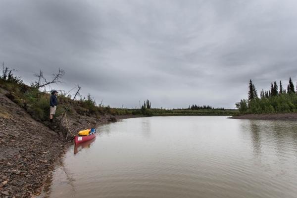 My friend Julien looking for a place to camp on the banks of the Eagle River
