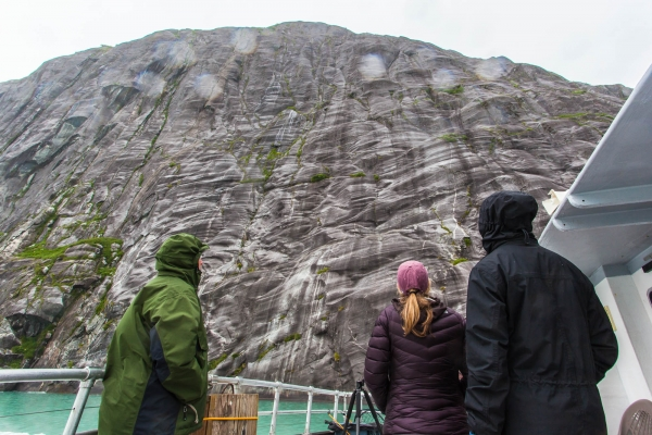Tourists looking at cliffs in Tracy Arm