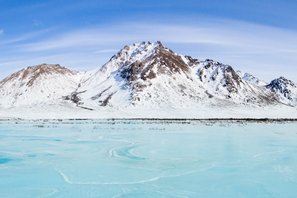 Frozen Blackstone River in Winter in Tombstone Territorial Park (Yukon, Canada)